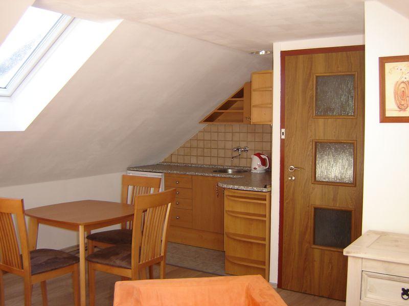 kuchyńka v apartmánu